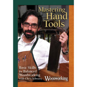 DVD cover for Mastering Hand Tools with Christopher Schwarz holding hand saw