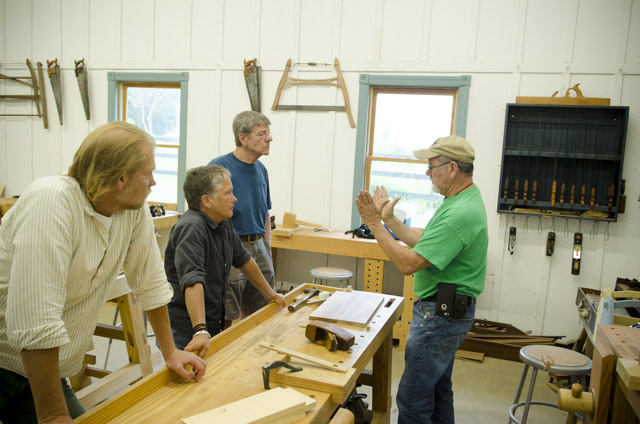 David Ray Pine teaching woodworking class students how hand plane a board with a coffin smoothing plane