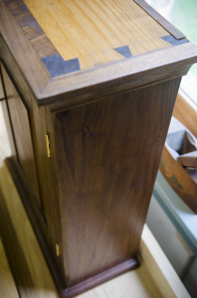 A top view of dovetails on a walnut cupboard in the Wood and Shop Traditional Woodworking School