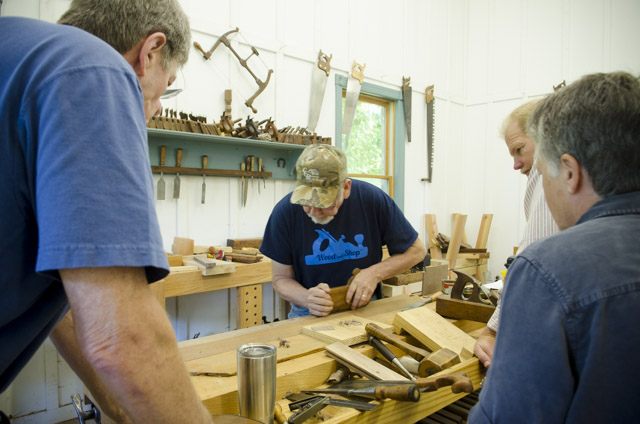 David Ray Pine teaching woodworking class students how to make moldings with a molding plane