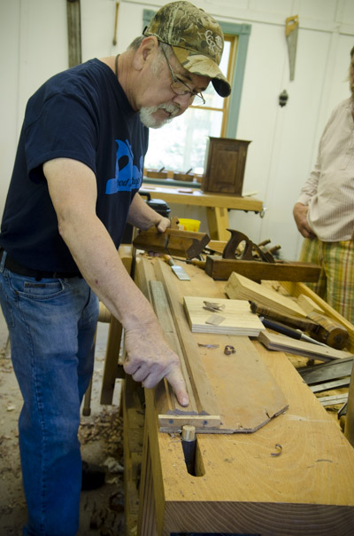 David Ray Pine cutting a custom walnut molding with hollows and rounds moulding planes