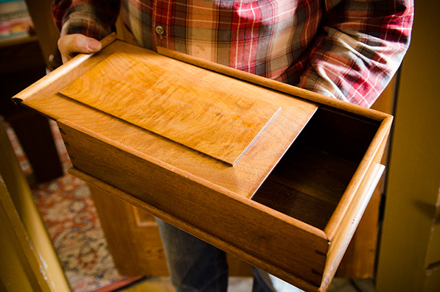 David Ray Pine sliding open the raised panel lid of a Moravian Candlebox