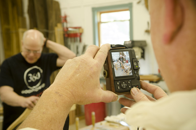 Will Myers taking a picture of a woodworking student at Joshua Farnsworth's Wood And Shop Traditional Woodworking School