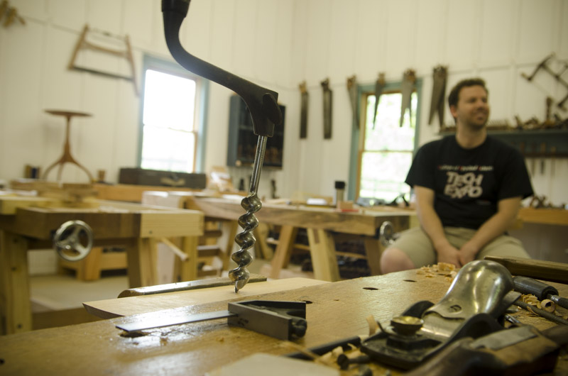 A brace and bit boring a hole at Joshua Farnsworth's Wood And Shop Woodworking School