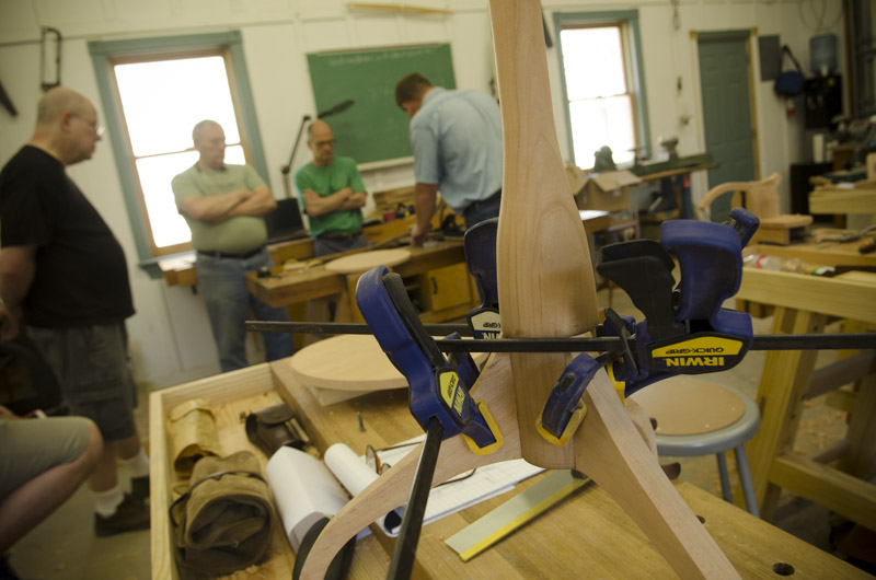 a sliding dovetail table leg being glued up with three clamps at Joshua Farnsworth's Wood And Shop Woodworking School