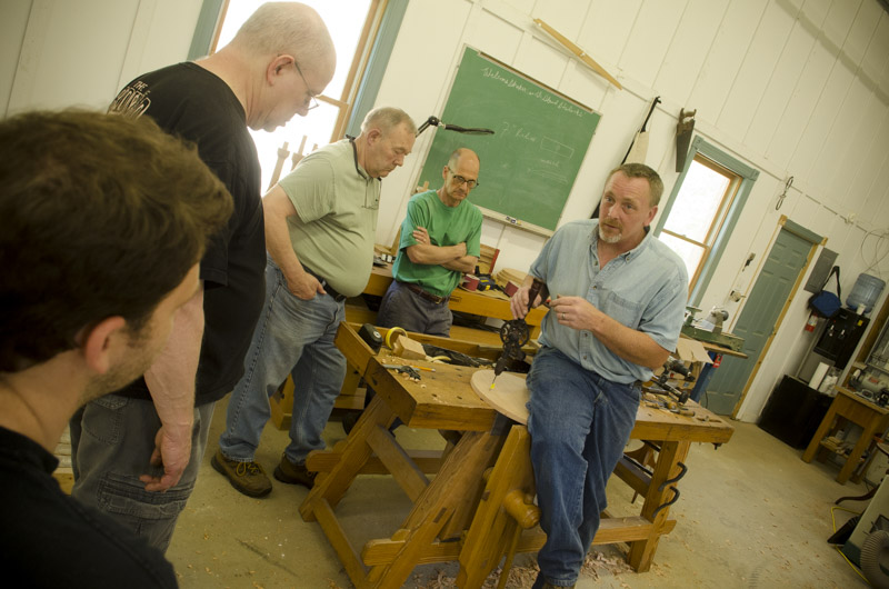 Will Myers teaching a group of students how to make a Hancock Shaker Candle Stand table at Joshua Farnsworth's Wood And Shop Woodworking School