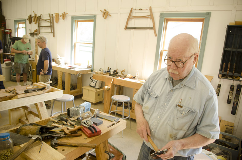 An older boat builder building a dovetail saw at Tom Calisto's class at the Wood And Shop Traditional Woodworking School
