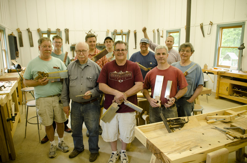 A group of woodworking student displaying their newly finished dovetail saws at Joshua Farnsworth's Wood And Shop Traditional Woodworking School