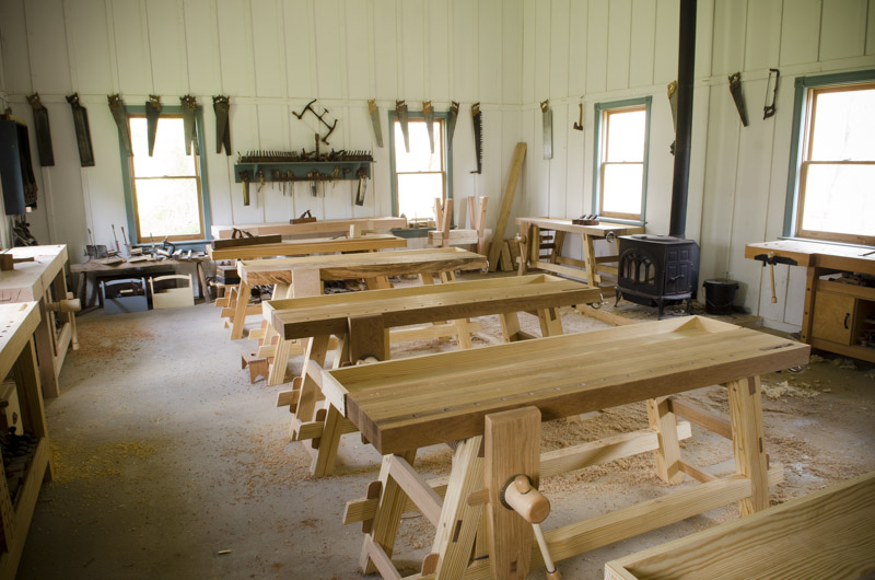 Wood and Shop traditional woodworking school with workbenches, antique hand tools, and wood stove