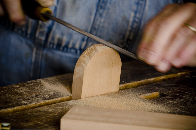 Bill Anderson using a rasp to smooth a handplane wedge while making a wooden bench plane