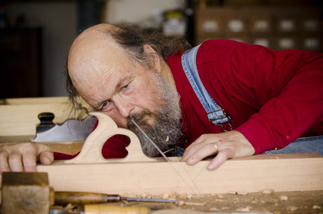 Bill Anderson inspecting the wooden bench plane that he's making