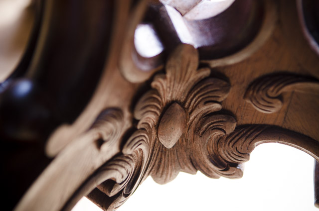 Kaare Loftheim carved flower detail on a candle stand at colonial williamsburg