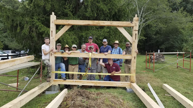 Woodworking Students at a timber framing or timber frame class at the wood and shop traditional woodworking school
