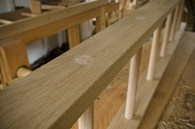 Wooden oak ladder on a woodworking workbench for ladder making class