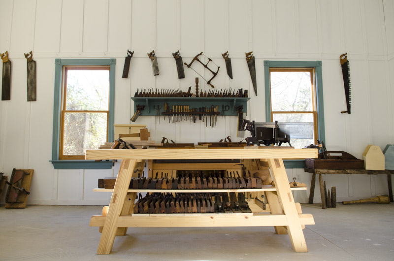 Portable Moravian workbench in the Wood and Shop Traditional Woodworking School with hand saws and hand planes