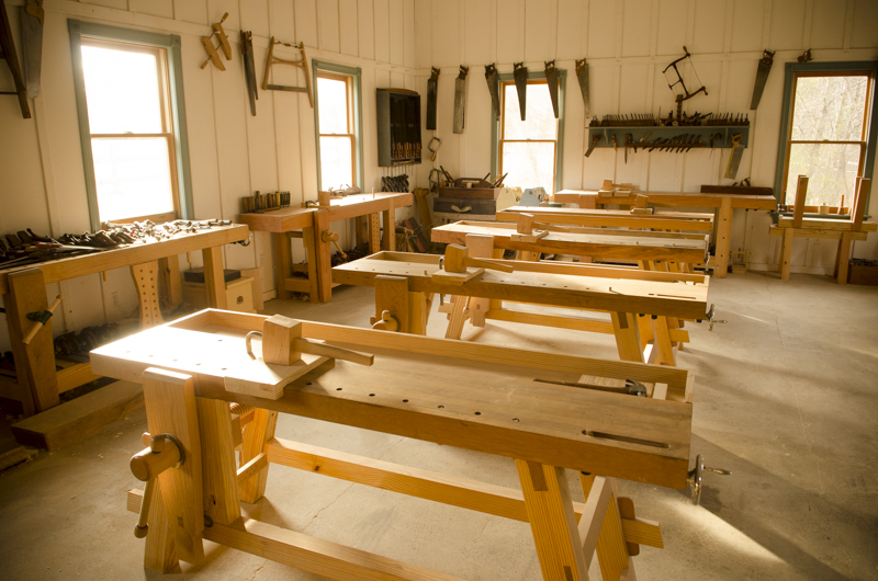 Moravian workbenches and Roubo workbenches lined up in the Wood and Shop Traditional Woodworking School