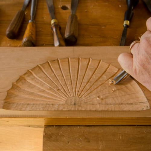 David Ray Pine wood carving a fan carving in a piece of cherry wood for a carving class
