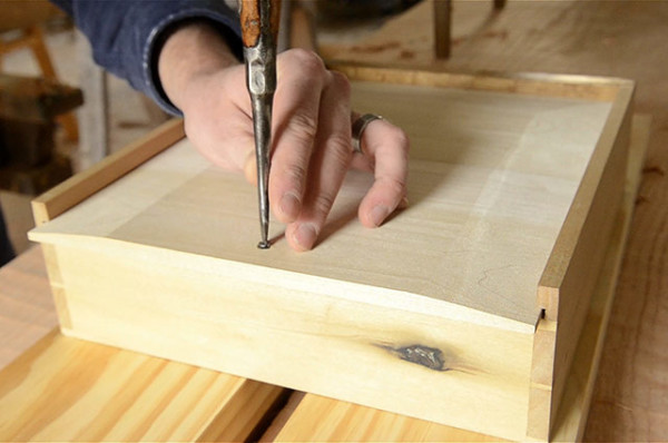 Adding a screw to a drawer bottom woodworking plans