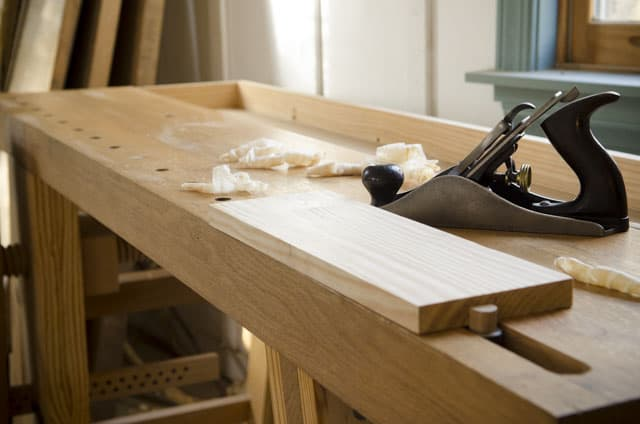 Portable Moravian Workbench with a board and hand plane